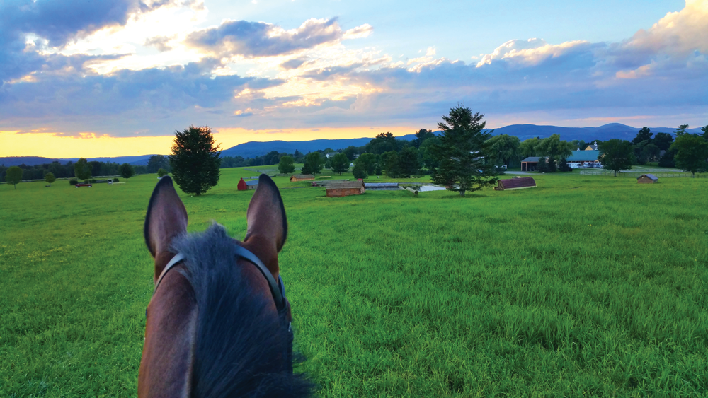 Sunset-between-horse-ears-at-Town-Hill-Farm,-Lakeville,-CT